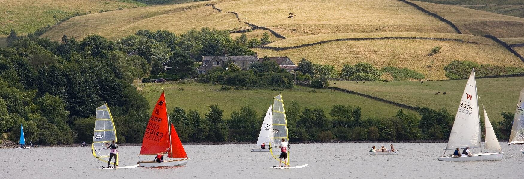 A group of small sailing boats on Hollingworth Lake.