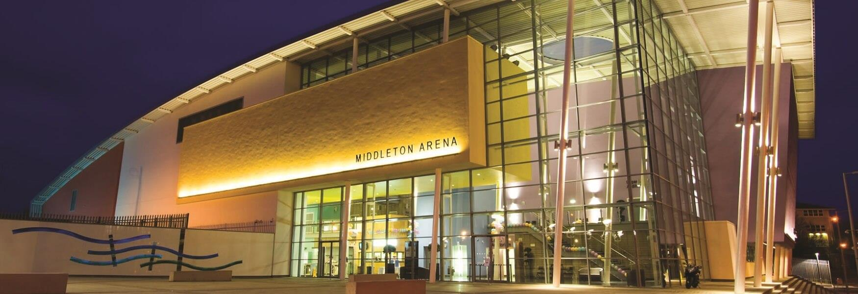 Exterior of Middleton Arena at night.