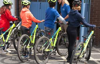 Young cyclists receiving instruction.